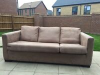 Lovely suede sofa with pouffe