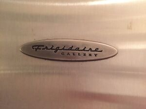 Frigidaire stainless steel fridge with water dispenser.