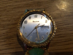 Bulova watch with gold nuggets and Jade inlaid in strap and dial