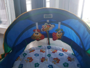 Colorful Fisher-Price baby bassinet with mobile tys