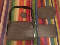 Stokke black melange changing bag, complete