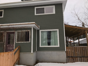 Unique and Charming Two Bedroom Half Duplex