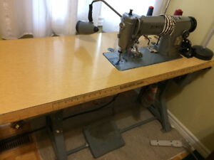 Singer industrial sewing machine with table.