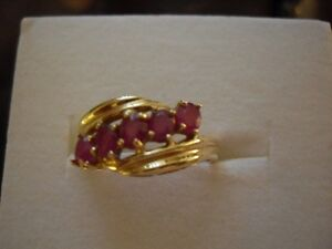 yellow gold ring with large genuine rubies