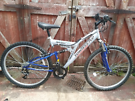 Duel suspension mountain bike.  Can deliver