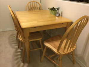 Solid wood kitchen table with hidden extension & four chairs