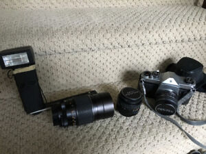 Vintage 55mm Pentax camera with lenses