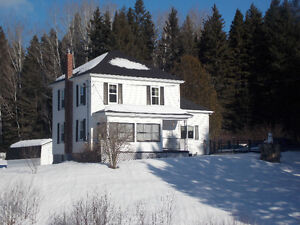 NEW LISTING - Charming home sitting on 18 acres of land!!