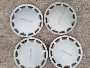 """Four 15"""" Taurus wheel covers forsale"""