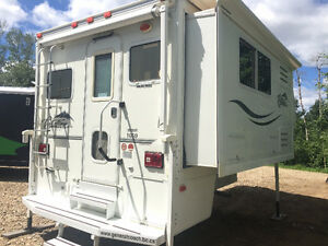 2006 Citation Supreme 1050 Truck Camper with electric slide out.