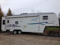 32' fifth wheel trailer with two slide outs