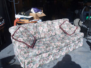 Floral couch for sale with two pillows
