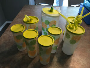 Tupperware juice container and glasses.