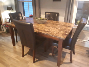 Faux Marble dining table with 6 leather chairs ( only 4 shown)
