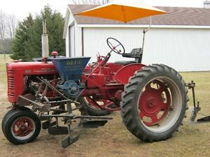 Farmall 200 with Cultivators , Sidedressers all the Attachments.
