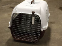 Pet Carrier and a Training Kennel