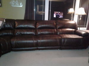 Leons Leather Sectional for sale