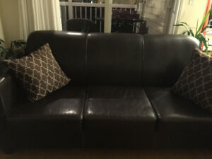 Couch and 2 dark wood end tables all for 175.00