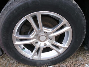 "4 15"" HONDA R SPORT RIMS WITH 205/65/15 TIRES"