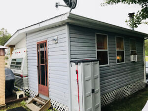 Cabin with Trailer in the Whiteshells.  Motivated seller.