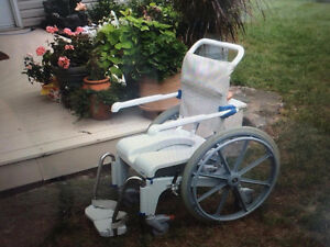 Aqua Tec roll-in shower chair/commode