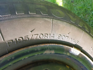 Set of 4 Uniroyal Tiger Paws 195/70R14 on rims. Fit Sunfire/Cava