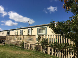 Updated mobile home on 3.5 acres of riverfront property