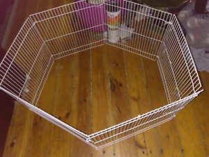 Small animal play pen and ground protector .