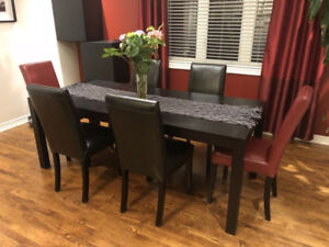 Modern dining table with faux leather chairs