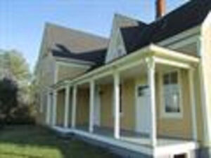STATELY COUNTRY HOME ON TEN ACRES IN GREAT COMMUNITY