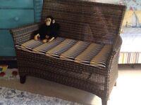 Gorgeous two seater Rattan sofa with cushion seat