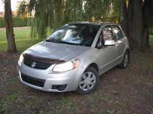 2009 Suzuki SX4 gris 5 portes