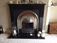 Granite surround with living flame gas fire