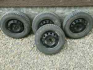 4 WINTER TIRES AND RIMS 185 65 14
