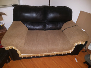 Comfortable part leather love seat