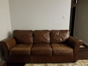 Real leather pull out sofa and loveseat