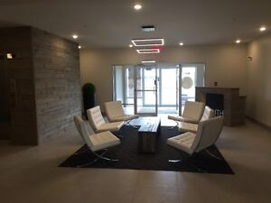 Nouveau condo Luxe Dix30 new Luxury condo plafond 9' garage incl