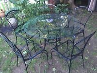 wrought iron bistro set, 5 chairs 2 tables