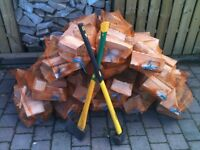 Logs/firewood/kindling for sale. Three bags for £10.