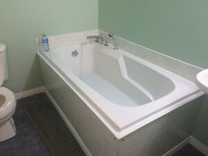 Air jet soaker tub