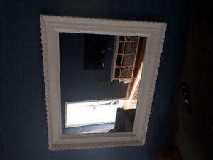 Antique mirror  4 feet x 3 feet..white in color,wood frame.