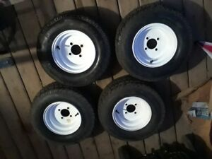 4 new tires and rims 20.5x8.0-10