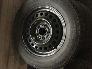1 year old winter tires and rims London Ontario image 1