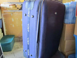 2 rolling suitcases  your choice $5 each