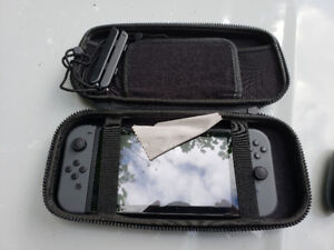Nintendo switch, case & 4 games