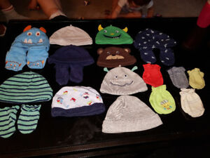 Carter newborn hats and scratch mitts almost all are new