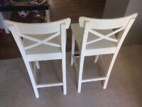 2 white IKEA Ingolf bar chairs
