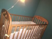 Baby cot with mattress and bedding