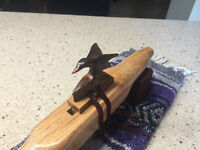 The body is Oak  with a Duck totem also in Rosewood. Key F#