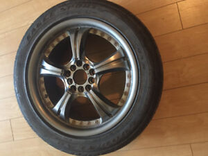 A set of Alloy rims with All seasons tires